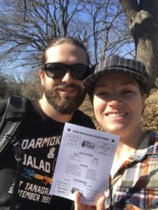 Two people hold voter information literature